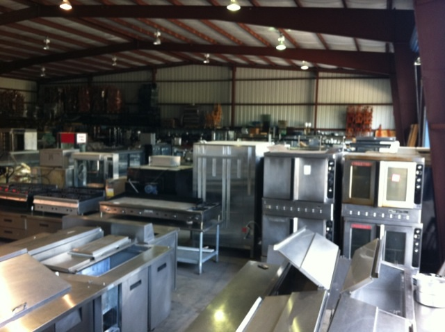 A full warehouse of used restaurant equipment one fat frog